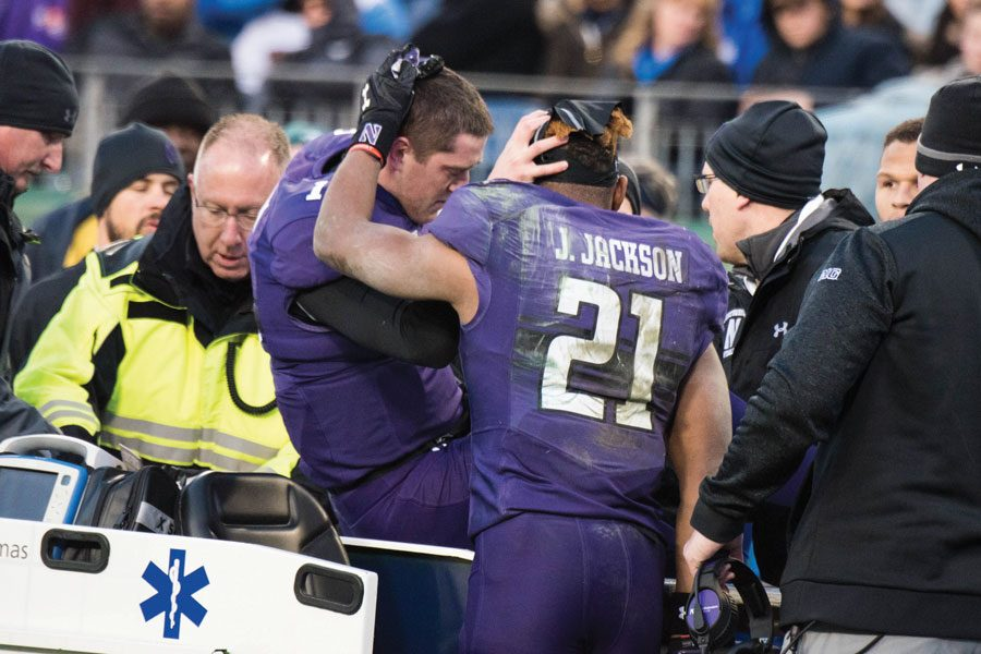 Thorson is consoled by running back Justin Jackson after suffering an injury in the 2017 Music City Bowl.