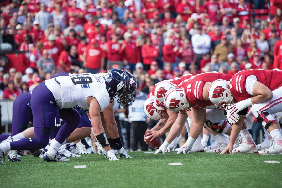 Northwestern and Wisconsin lines face off during last season's game in Madison. The Badgers won 33-24 en route to another Big Ten West division title.