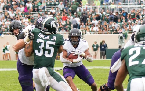 Solomon Vault looks for a hole in the Michigan State defense. Vault has overcome multiple injuries to become the Cats' lead running back.