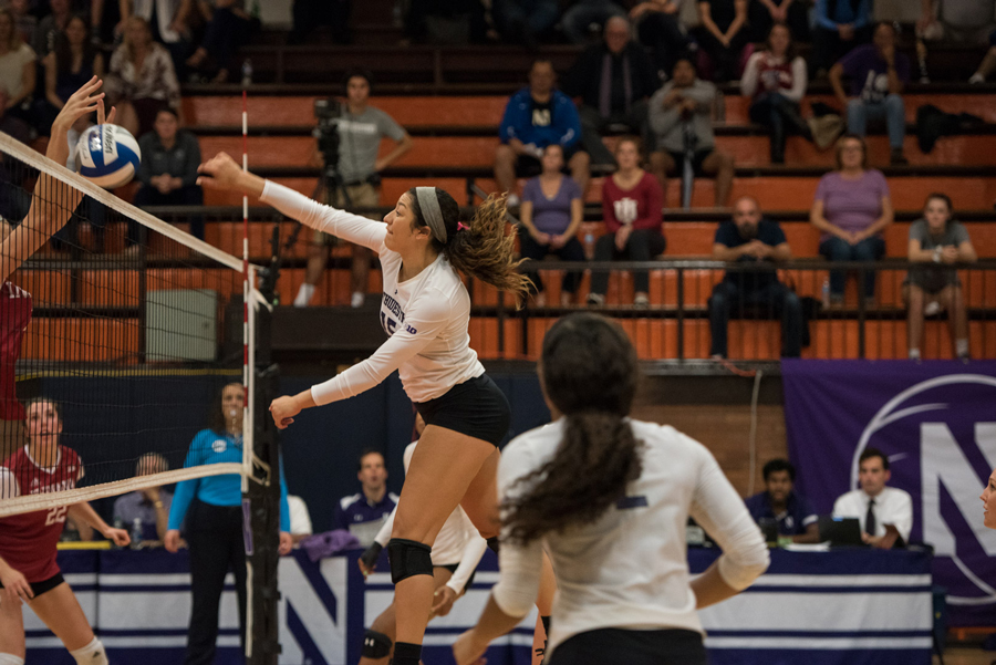 Danyelle Williams strikes a volleyball. The sophomore outside hitter had seven kills in 11 attempts against Iowa.