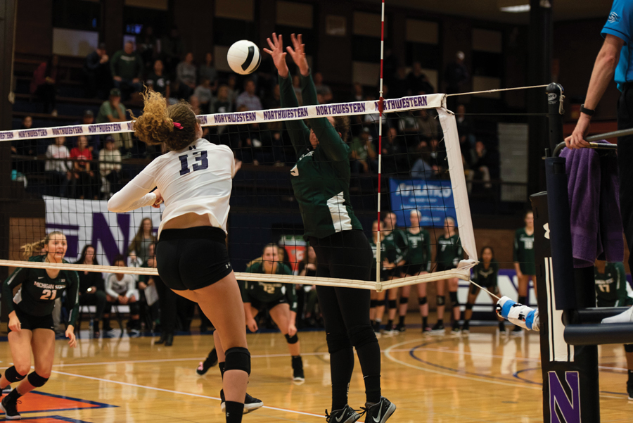 Olivia Viscuso hits the ball. The junior middle blocker has played in 21 games for the Wildcats this season.