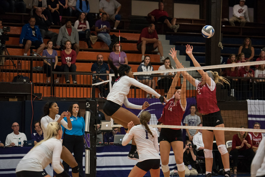 Alana Walker follows through on a kill. The sophomore middle hitter is third on the team in attempts this year.