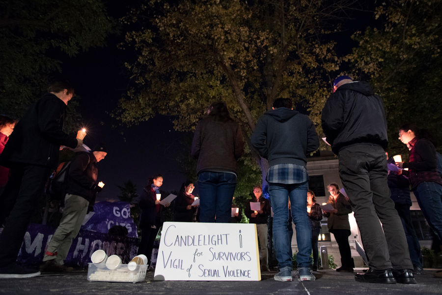 A candlelight vigil at the Rock. CaSA held the vigil Thursday to show support for survivors of sexual abuse.