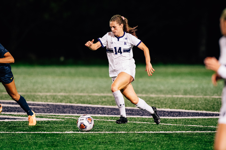 Marisa Viggiano dribbles the ball. The senior midfielder scored the equalizer in the 74th minute.