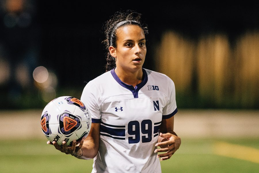 Freshman+defender+Julietta+Thron+prepares+to+throw+the+ball+in.+The+Wildcats+failed+to+qualify+for+the+Big+Ten+Tournament.+