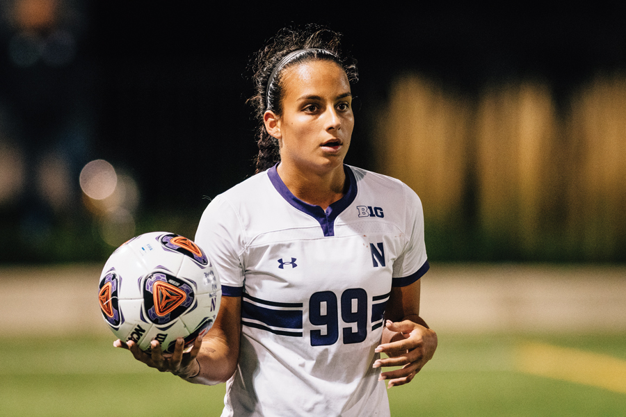 Freshman defender Julietta Thron prepares to throw the ball in. The Wildcats failed to qualify for the Big Ten Tournament.