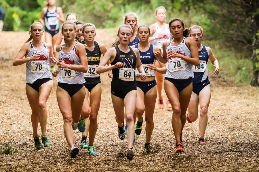 Aubrey Roberts leads a pack of runners. The junior finished in second at the Big Ten Championships.
