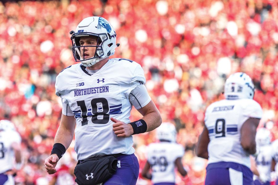 Thorson warms up prior to Northwestern's 2017 game at Wisconsin.