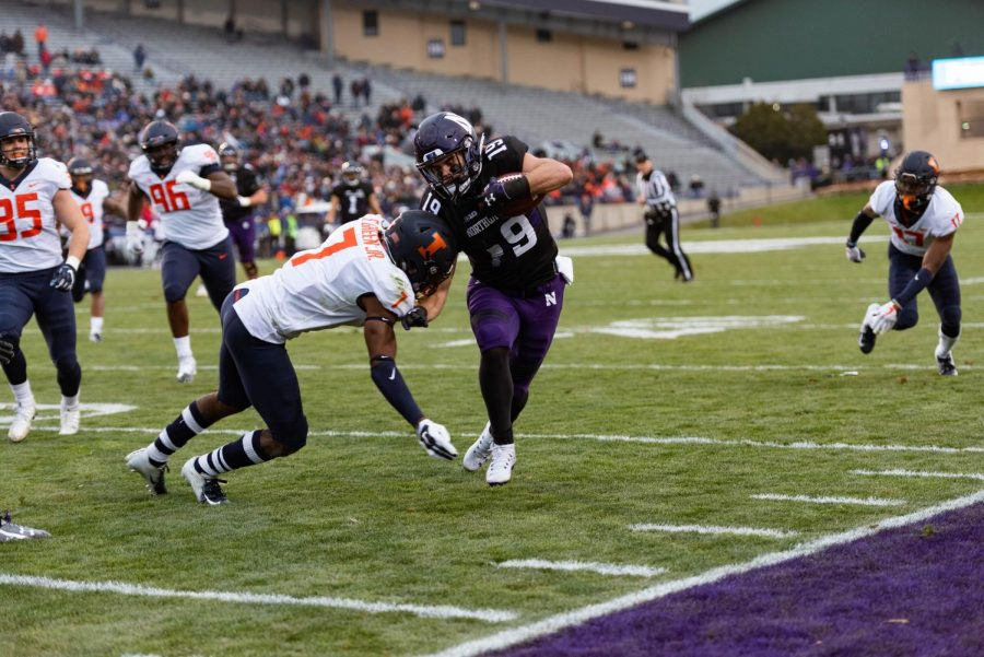 Northwestern+receiver+Riley+Lees+tries+to+evade+an+Illinois+defender+during+the+first+half+of+Saturday%27s+game.+NU+took+a+big+lead+at+halftime+and+held+on+to+win.