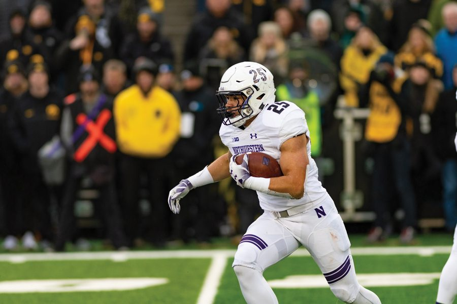 Isaiah Bowser runs the ball. The freshman running back gained 156 yards on 31 carries en route to Rose Bowl Big Ten Player of the Week.