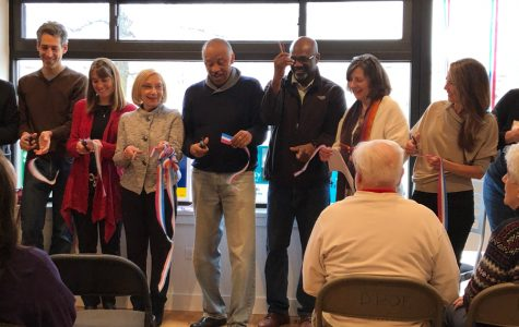 Politicians during the ribbon-cutting ceremony at the new DPOE office. The Democratic Party of Evanston relocated to a bigger office space early this month.