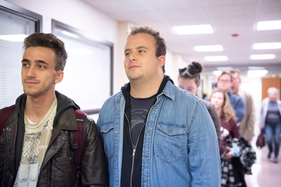 Medill senior Adam Yates and SESP junior Matthew Zients wait in line to vote early at the Lorraine H. Morton Civic Center on November 5, 2018.