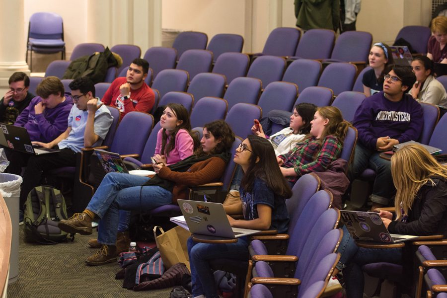 Students react to election results at a Harris Hall watch party. On campus, enthusiasm for politics and the impending midterm elections seemed infectious.