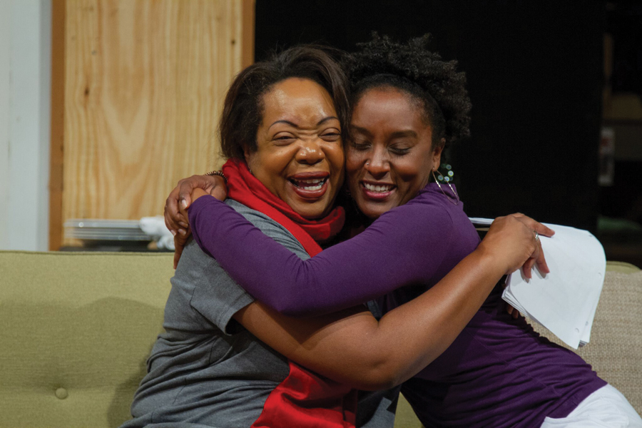 "Two actors embrace while rehearsing for ""Familiar."" The show, written by actor/playwright Danai Gurira, focuses on a family of Zimbabwean-Americans living in Minnesota."