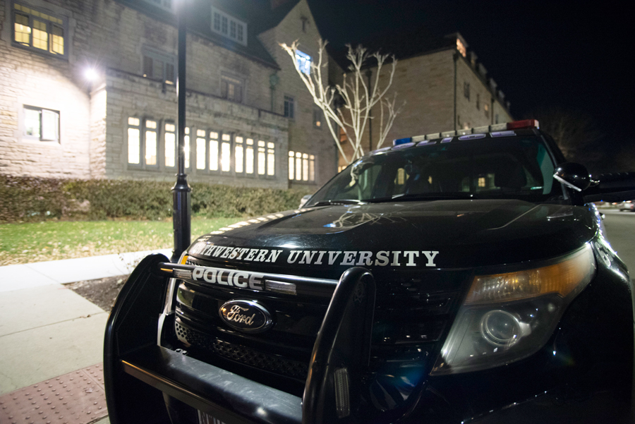 University Police car parked in the Sorority Quad Tuesday night. University Police has been responding to recent incidents by increasing patrol on and around Northwestern's Evanston campus.