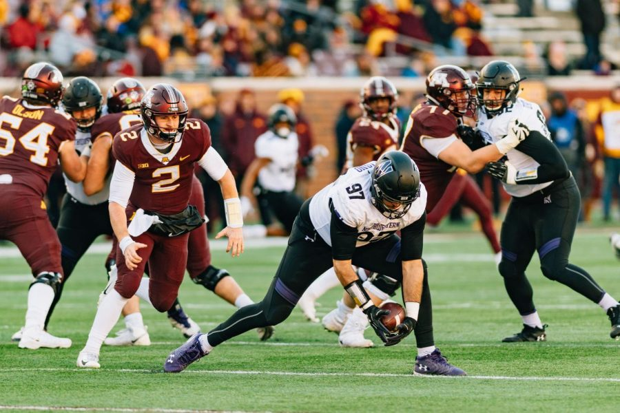 Joe Gaziano recovers a fumble. Northwestern's defense came up huge in a win at Minnesota.