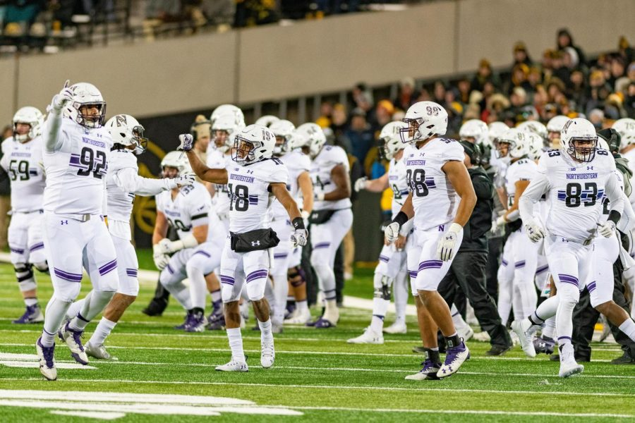 Northwestern players celebrate after a touchdown. The Wildcats clinched the Big Ten West with a win against Iowa.