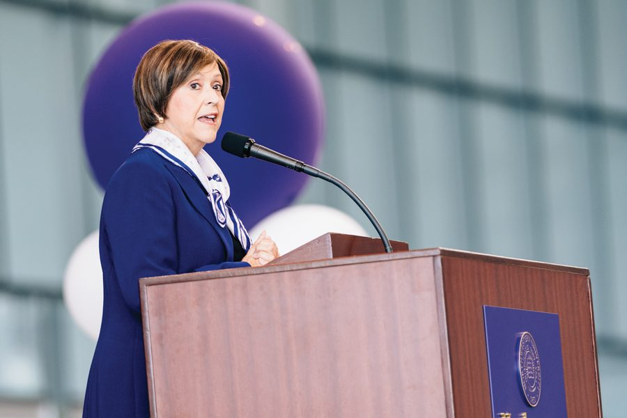 """Patricia Telles-Irvin speaks at convocation. Though Telles-Irvin spoke about creating a """"community of care"""" within the student body, some think the University could be doing more."""