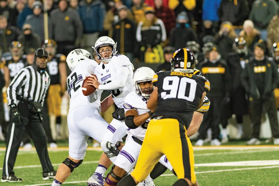 Clayton Thorson surveys the field against Iowa. The senior quarterback has had wildly divergent performances this season.