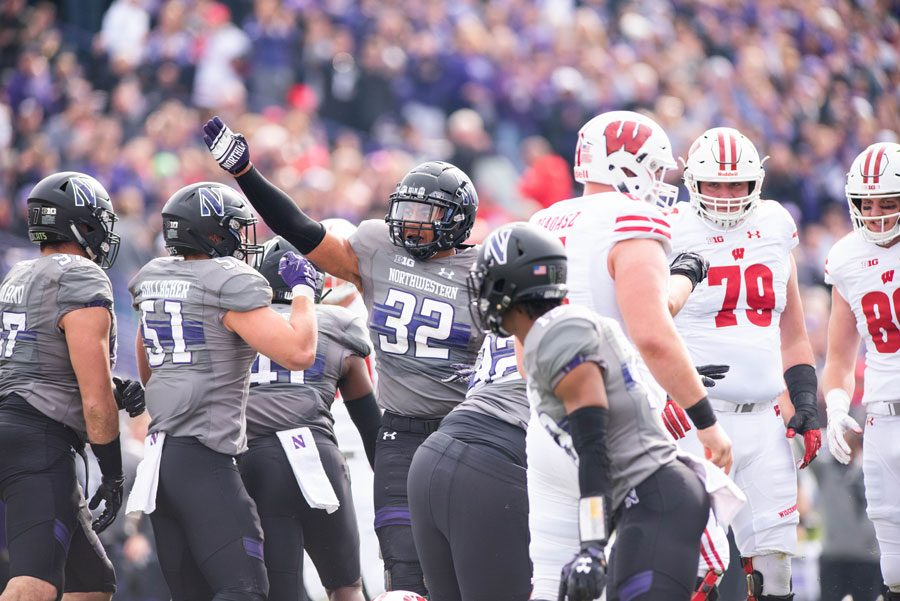 Nate Hall celebrates among teammates against Wisconsin. Hall returned against the Badgers following a pair of injuries in the past season.