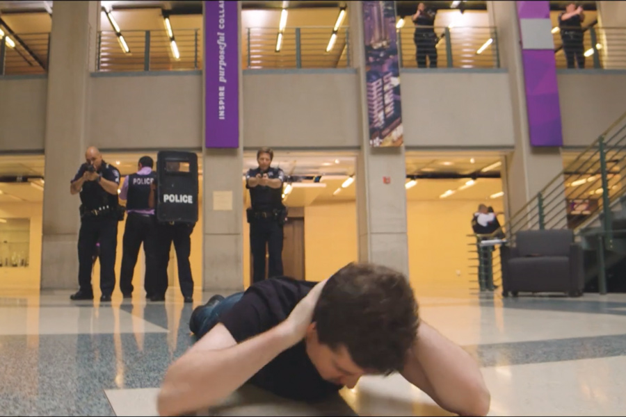 """An actor portraying an active shooter surrenders to University Police. UP released the """"Run, Hide, Fight"""" training video Thursday."""