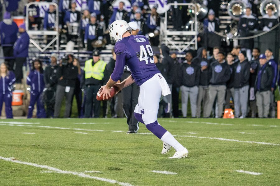 Jake+Collins+punts+the+ball+into+the+Evanston+night.+The+senior+punter+has+been+one+of+Northwestern%E2%80%99s+most+consistent+performers+this+season.+