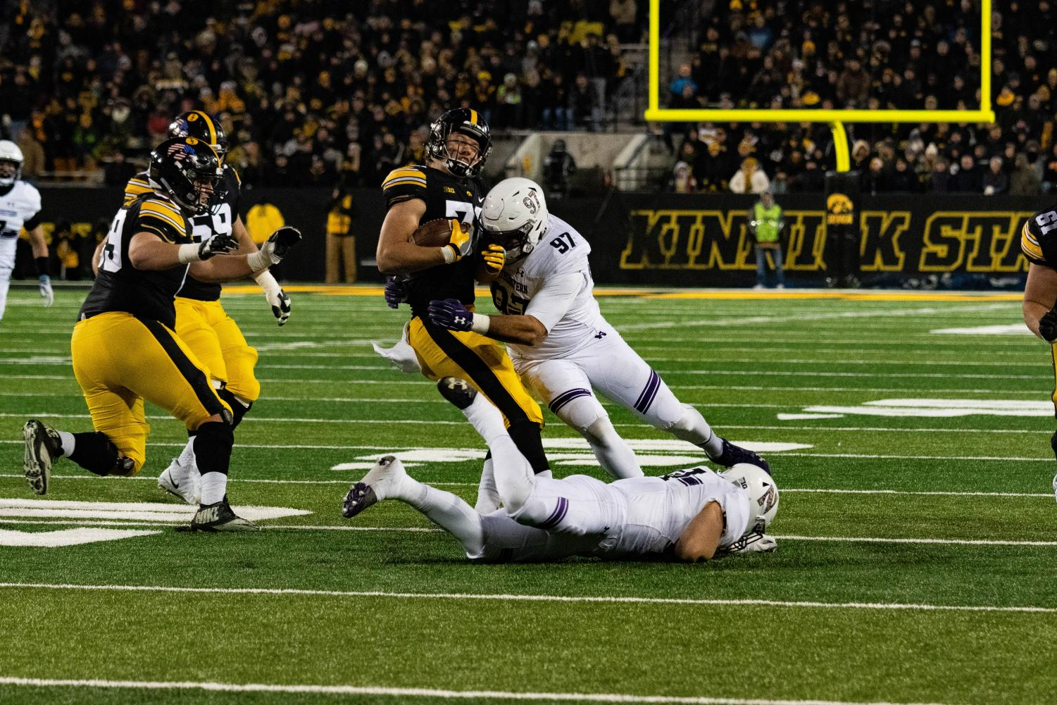 Joe Gaziano tackles an Iowa player. The junior defensive game was a key factor in Northwestern's win over No. 21 Iowa.