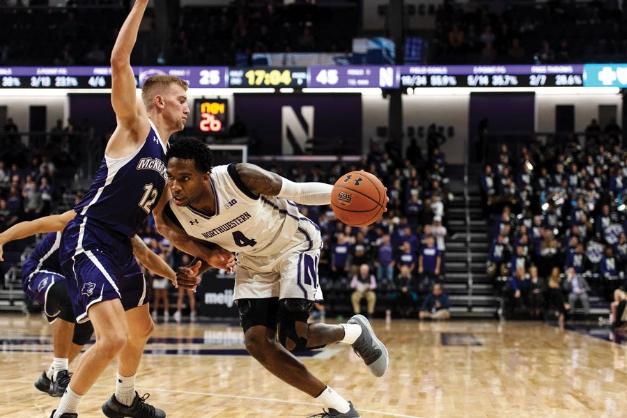 Vic+Law+attacks+the+basket.+The+senior+forward+will+lead+Northwestern+in+2018-19.+
