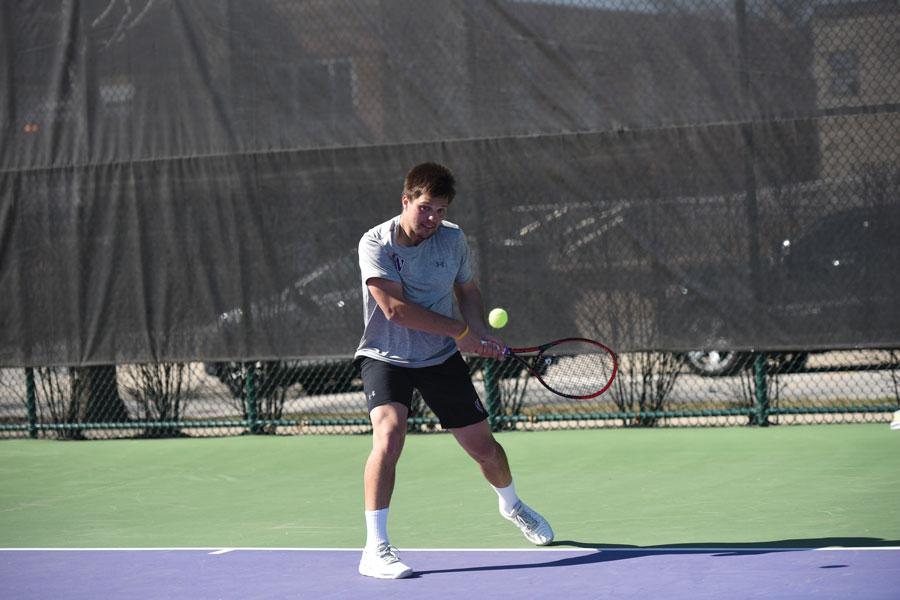 Dominik Stary hits a shot. The junior won the Big Ten Singles title.