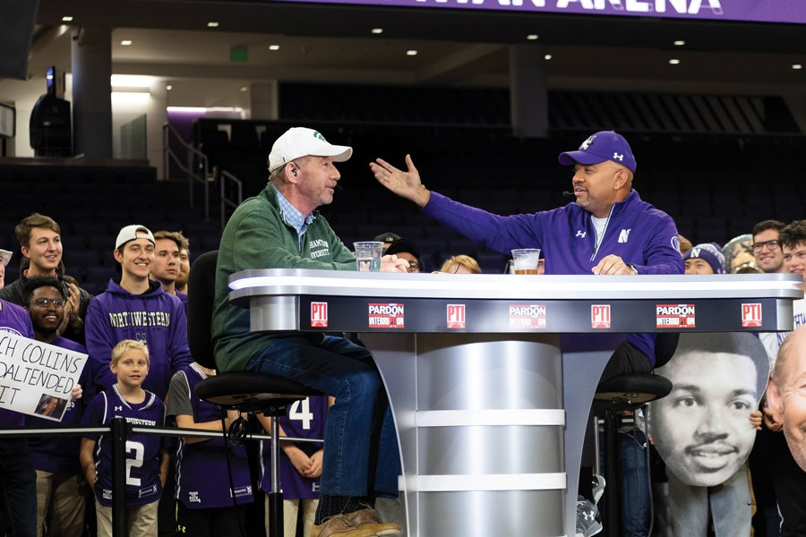 "Michael Wilbon and Tony Kornheiser banter in front of a group of Northwestern students. ""Pardon the Interruption"" aired their Friday show from Welsh-Ryan Arena."