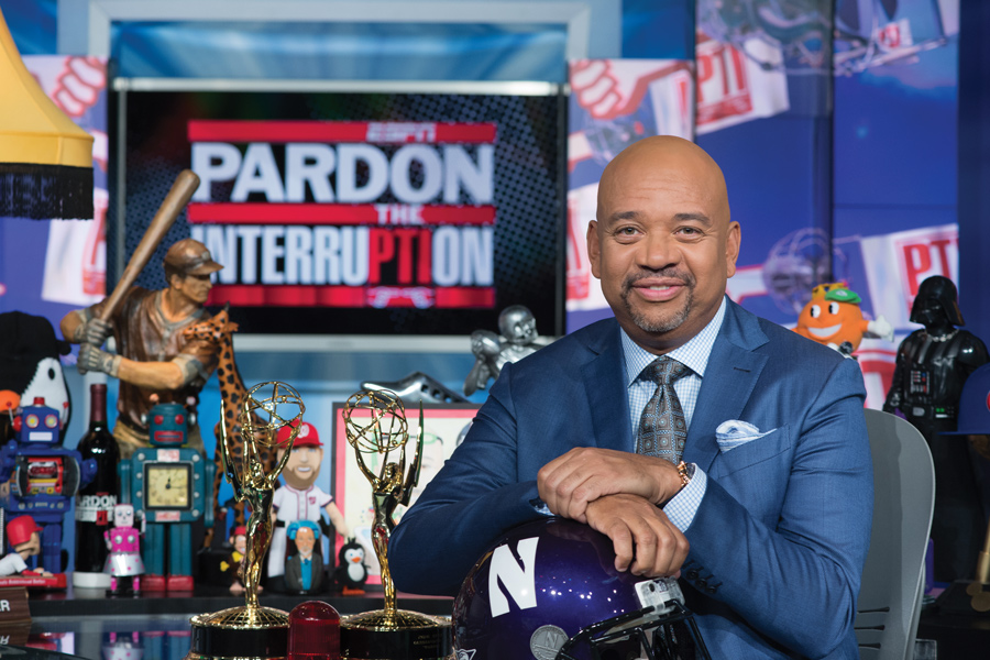 Michael Wilbon (Medill '80) poses on the set of ESPN's 'Pardon The Interruption.' The show will broadcast from Welsh-Ryan Arena on Friday.