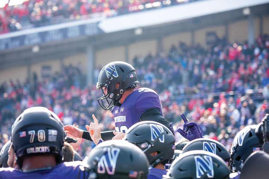 Drew+Luckenbaugh+is+paraded+by+teammates.+The+sophomore+kicker%E2%80%99s+game-winning+field+goal+against+Nebraska+was+part+of+yet+another+close+game+for+Northwestern.