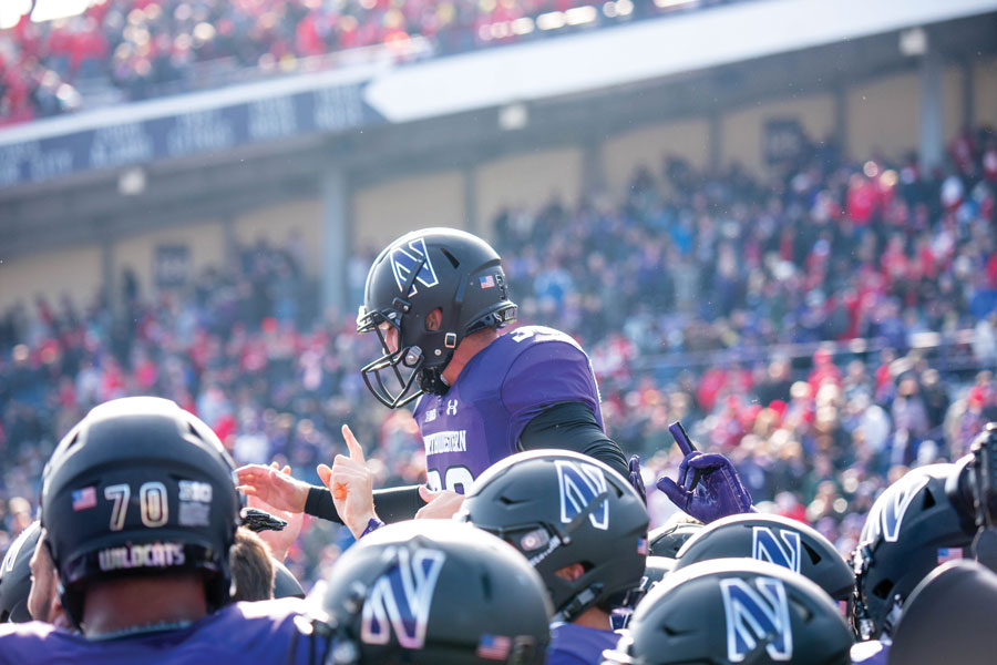 Drew Luckenbaugh is paraded by teammates. The sophomore kicker's game-winning field goal against Nebraska was part of yet another close game for Northwestern.