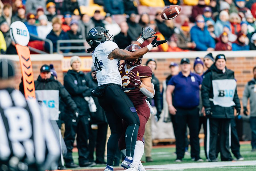 Cameron Green reaches over a defender to make a catch. Many things went right for Green and the Wildcats in their 24-14 win over Minnesota on Saturday.