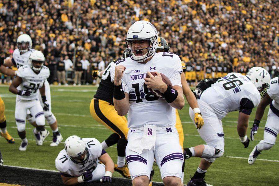 Clayton Thorson celebrates a touchdown against Iowa in 2016. Thorson and the Wildcats return to Kinnick Stadium for a pivotal contest on Saturday.