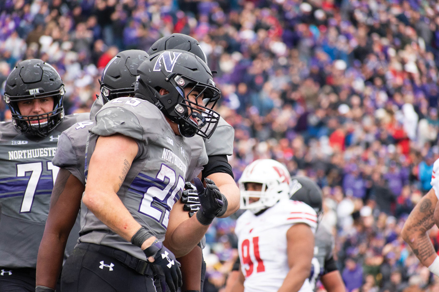 Isaiah Bowser celebrates a touchdown in Northwestern's game against Wisconsin. Bowser has become a celebrity in his hometown of Sidney, Ohio.