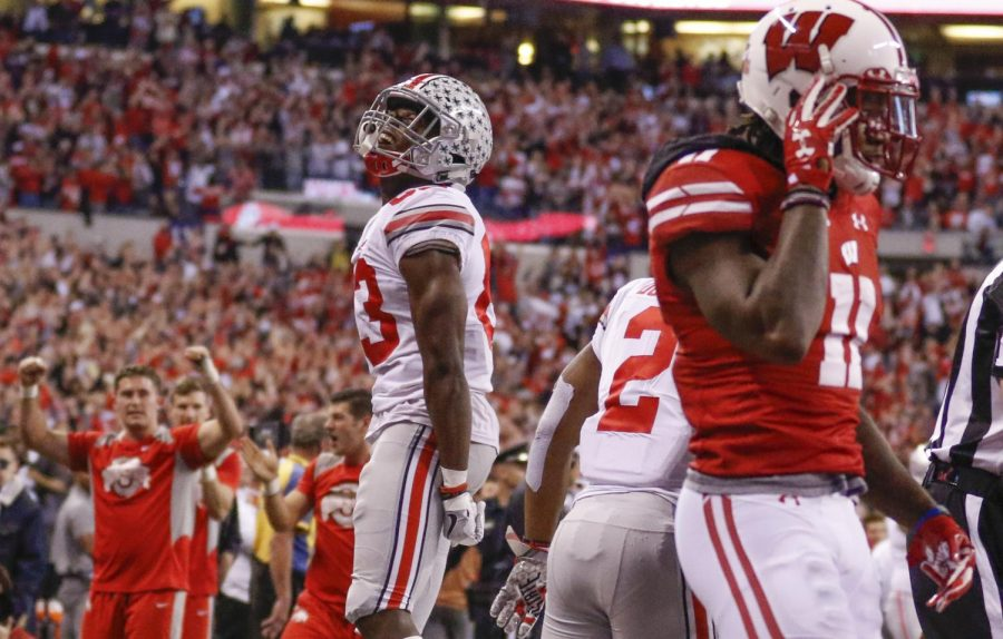 Ohio+State+players+and+fans+celebrate+in+the+2017+Big+Ten+Championship+Game.+Playing+on+such+a+stage+can+allow+teams+to+boost+their+national+profiles.