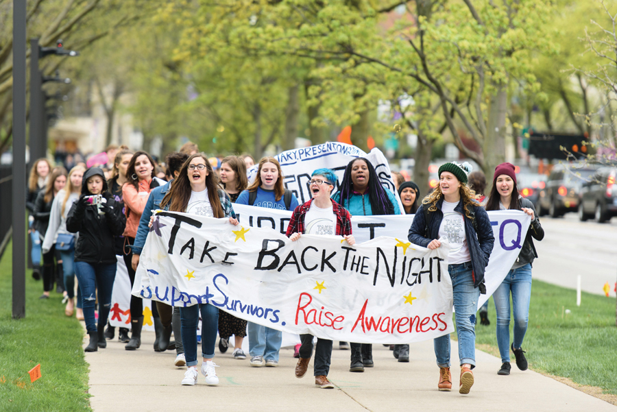 Students march down Sheridan Road in a 2017 Take Back the Night march, an annual event aimed at supporting survivors of sexual assault. New Title IX regulations proposed by the U.S. Education Department will bolster the rights of students accused of sexual assault.