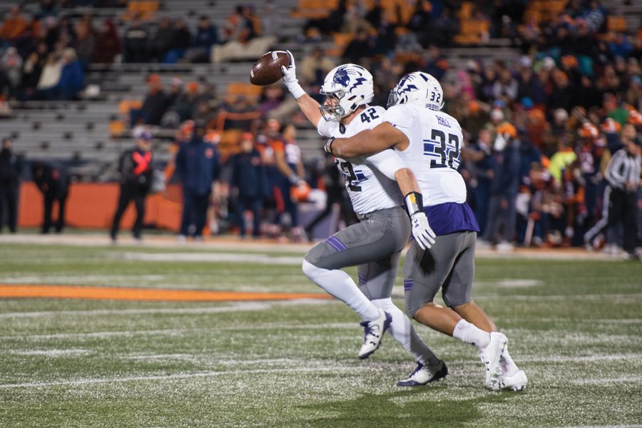 Paddy Fisher (left) and Nate Hall celebrate a fumble recovery against Illinois last year. The Wildcats will look for more big plays against the Fighting Illini in Saturday's rivalry.
