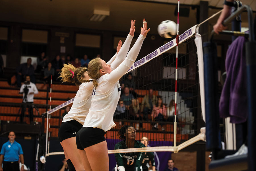Britt Bommer and Ella Grbac jump for a block. Bommer and Grbac will look to help the Wildcats pick up two victories this weekend.