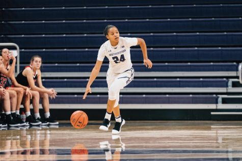 Women's Basketball: Pulliam's late free throws give NU upset victory over Green Bay