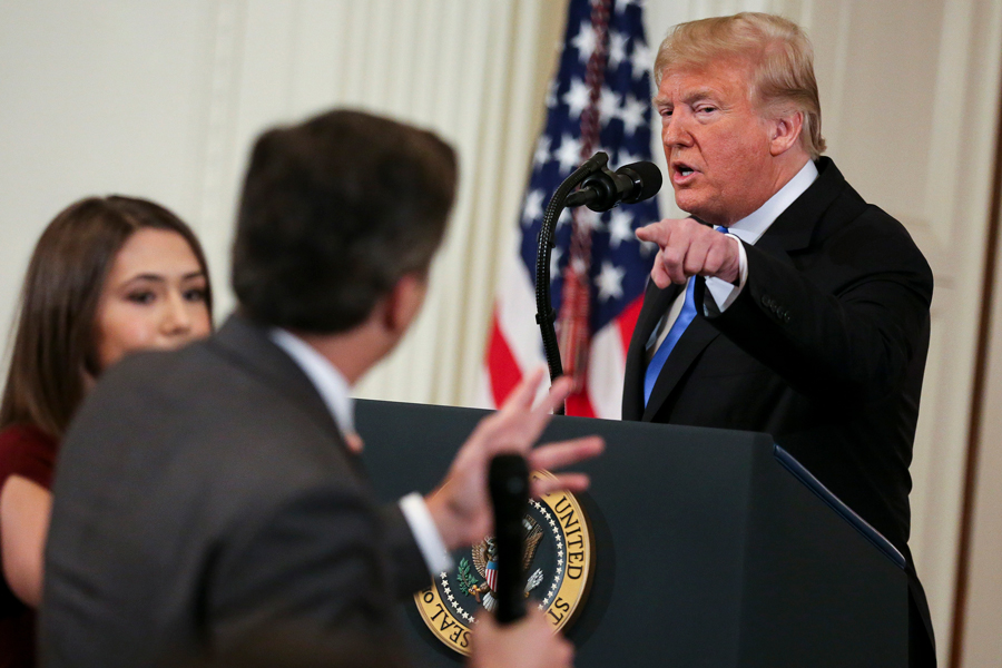 A White House staff member, left, tries to take away the microphone from CNN White House correspondent Jim Acosta during an exchange with President Donald Trump on Wednesday, Nov. 7, 2018. Medill interim Dean Whitaker spoke out against the president's decision to revoke Acosta's credentials in a statement on Friday.