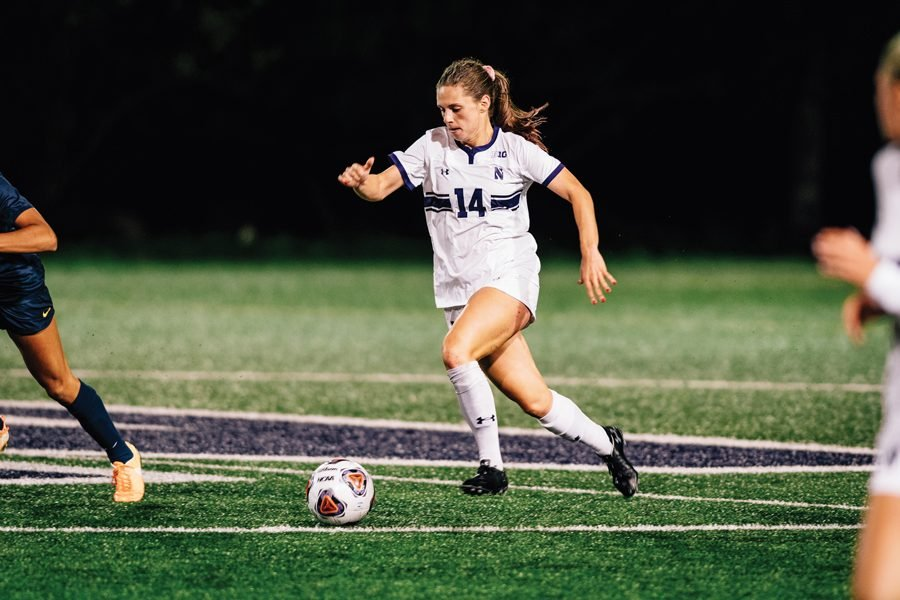 Marisa+Viggiano+dribbles+the+soccer+ball.+The+senior+midfielder+played+her+final+game+for+the+Wildcats+on+Friday.