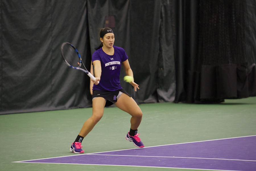 Caroline Pozo prepares to hit the ball. The sophomore won two of her three matches this weekend.