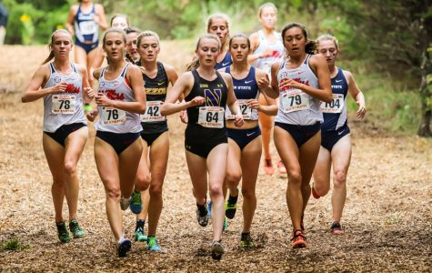 Aubrey Roberts leads a pack of runners. The junior will make her third appearance at NCAA Championships next weekend.