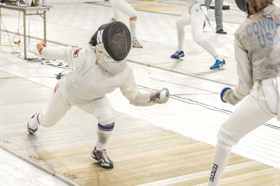 A Northwestern fencer attacks their opponent. The Wildcats left New York with a 8-0 record this weekend.