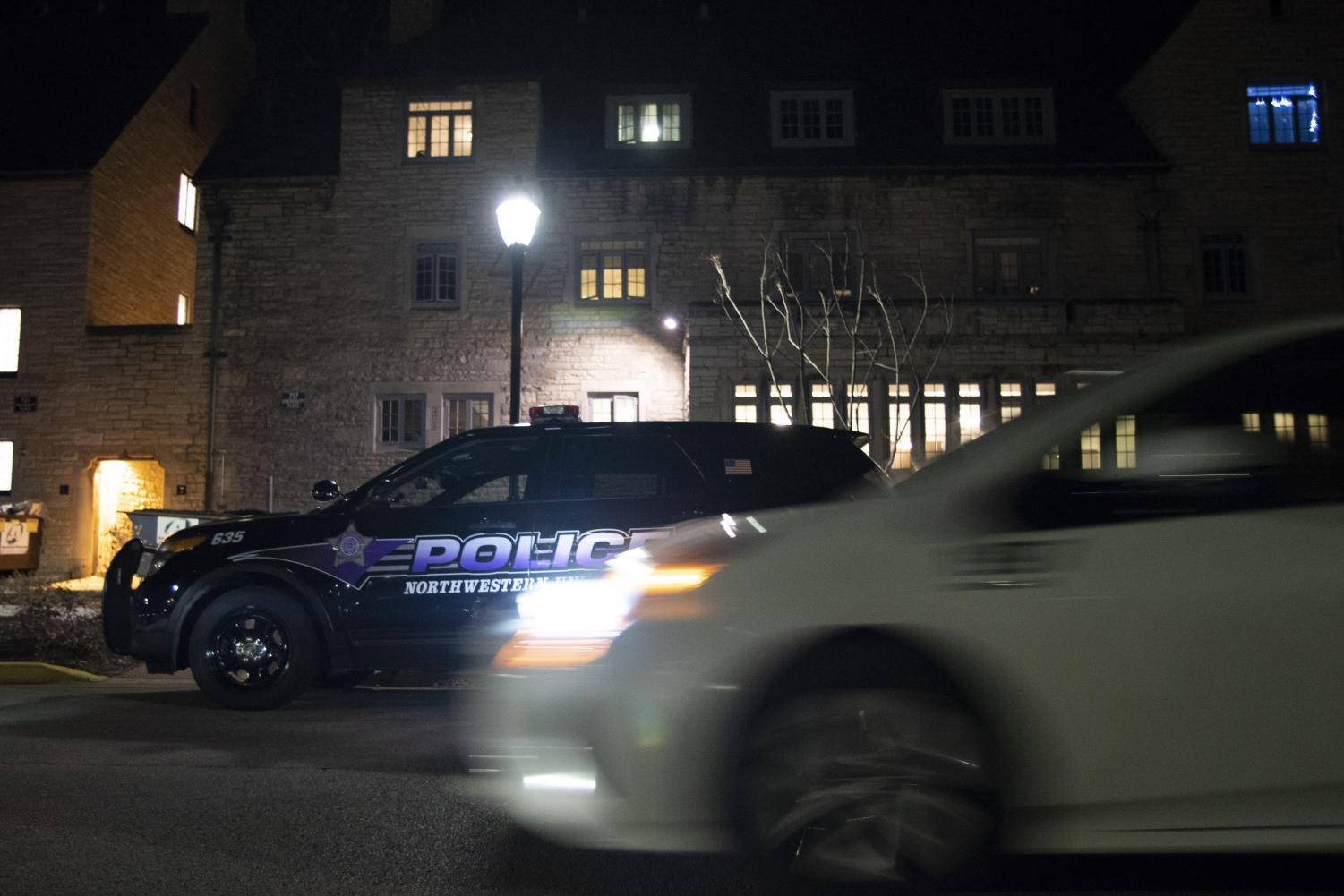 A Safe Ride drives past a University Police car near the Sorority Quad. Safe Ride has suspended its three block minimum distance in response to reports of men targeting women on and near Northwestern's Evanston campus.