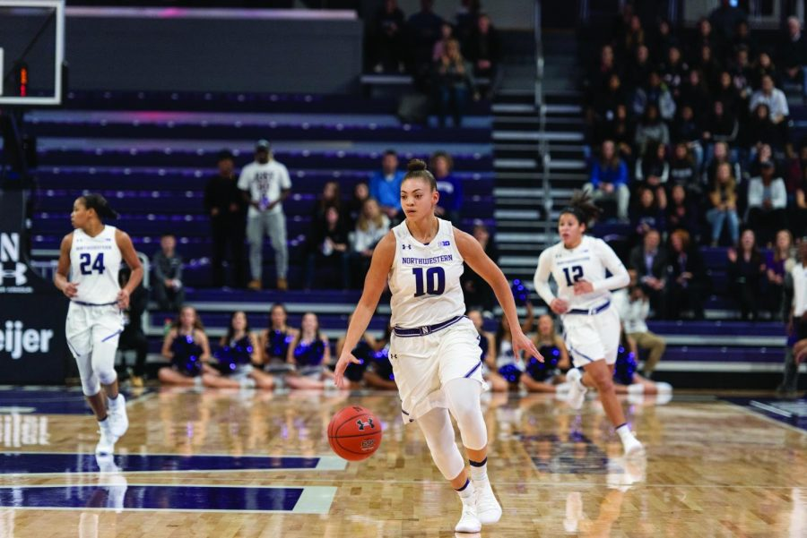 Lindsey+Pulliam+races+down+the+floor.+The+sophomore+guard+was+the+Wildcats%E2%80%99+leading+scorer+in+the+Duel+in+the+Desert.+