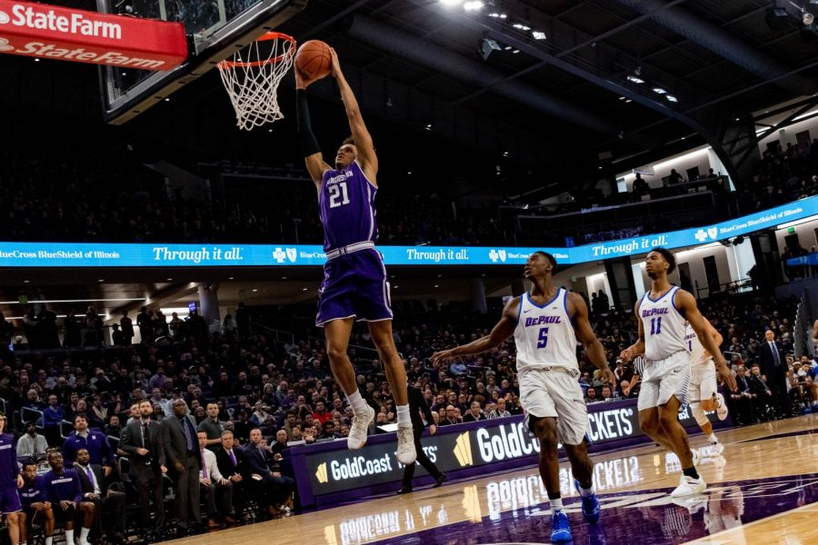 A.J.+Turner+rises+for+a+two-handed+slam.+The+junior+forward+had+24+points+Saturday+against+DePaul.