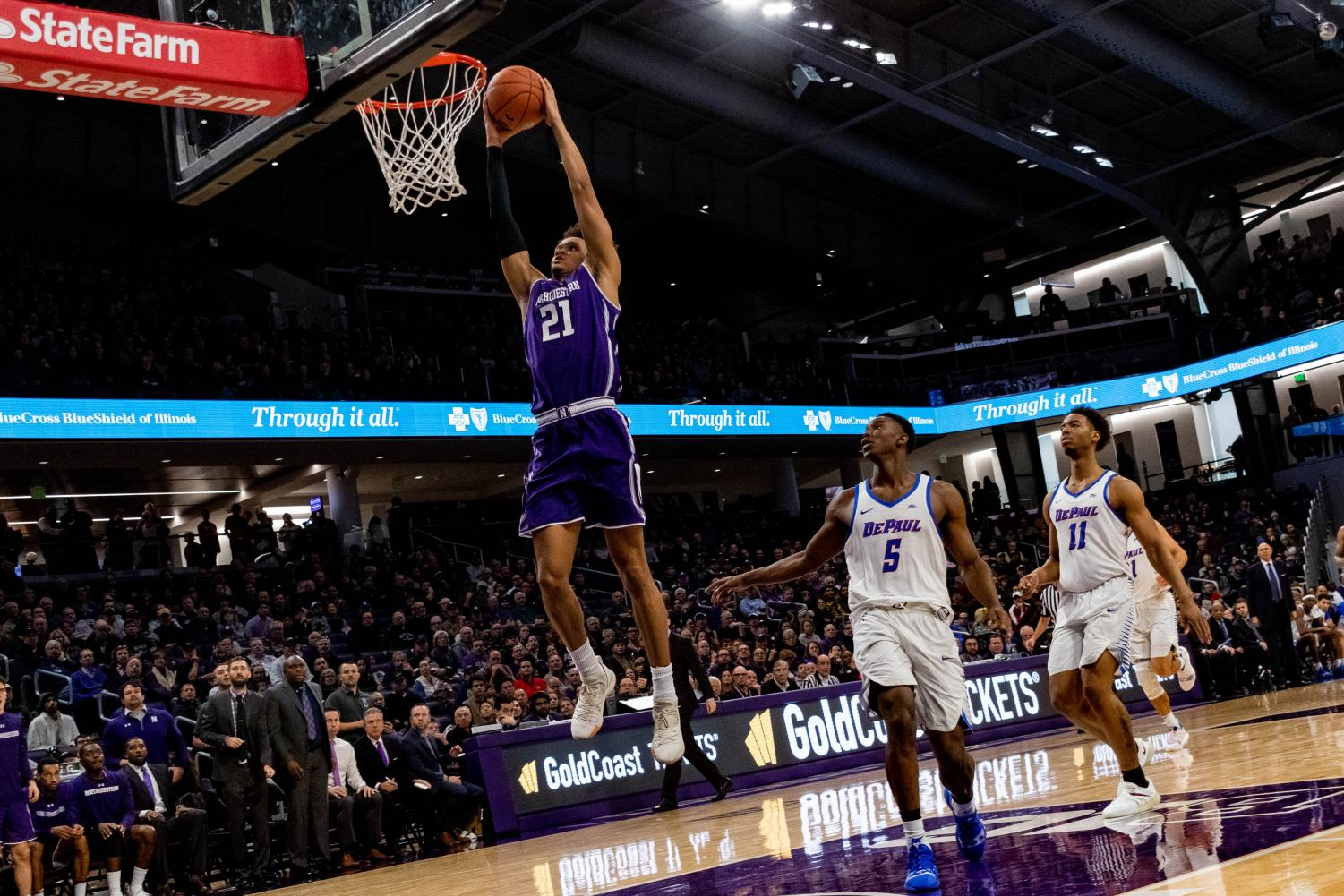 A.J. Turner rises for a two-handed slam. The junior forward had 24 points Saturday against DePaul.